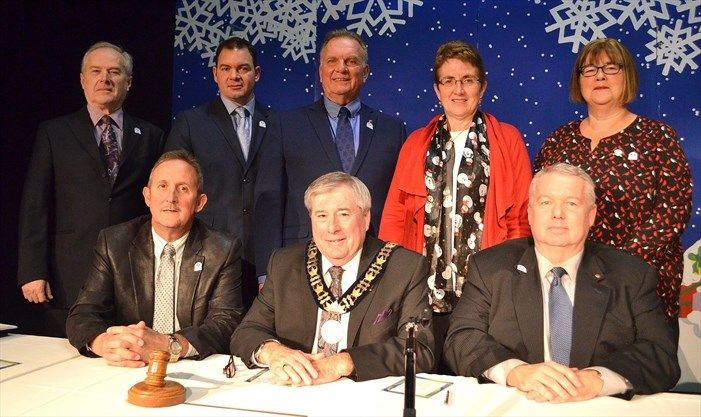 The Town of Minto's recently elected municipal council officially took office on Dec. 4 in Harriston. Pictured, back row from left: Councillors Mark MacKenzie, Geoff Gunson, Ron Elliott, Judy Dirksen and Jean Anderson. Front: Deputy Mayor Dave Turton, Mayor George Bridge and CAO Bill White. - Dan McNee/Metroland